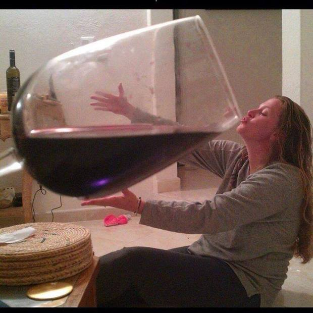 Woman drinks huge glass of wine richard wiseman for Large red wine glass